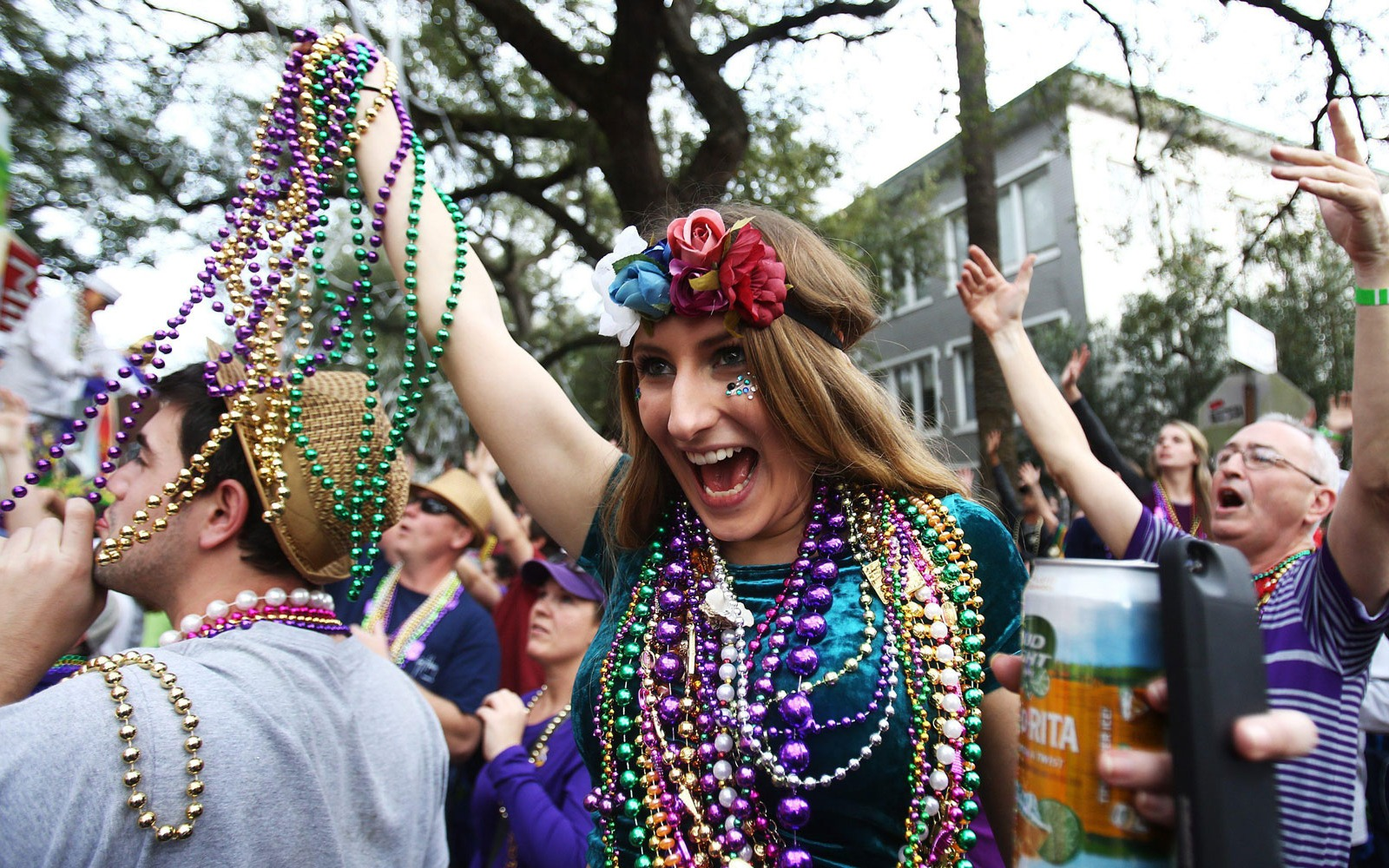 New Orleans Mardi Gras carnival goers with beads and headresses