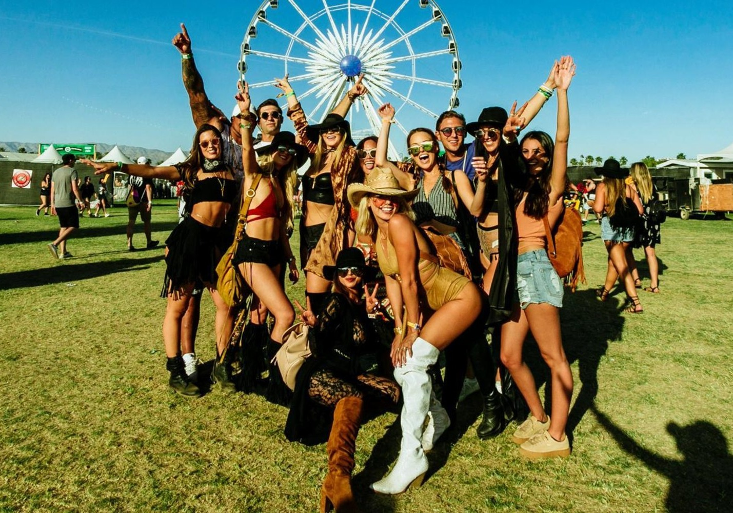beautiful festival-goers posing at coachella festival