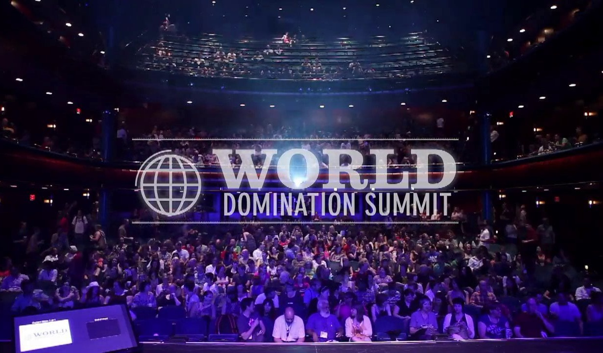 world domination summit wording over audience at event