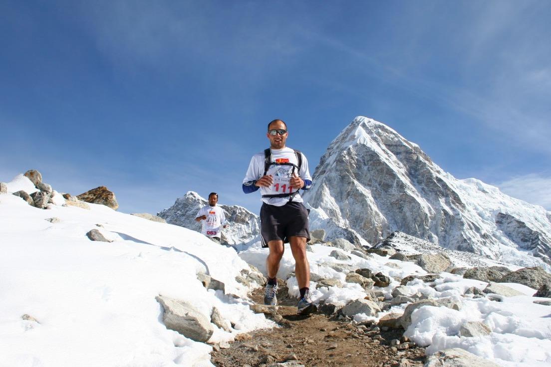 Runner with snowy mountain behind in Everest Marathon