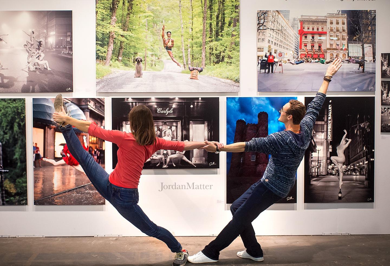 Visitors looking at art work at Artexpo New York