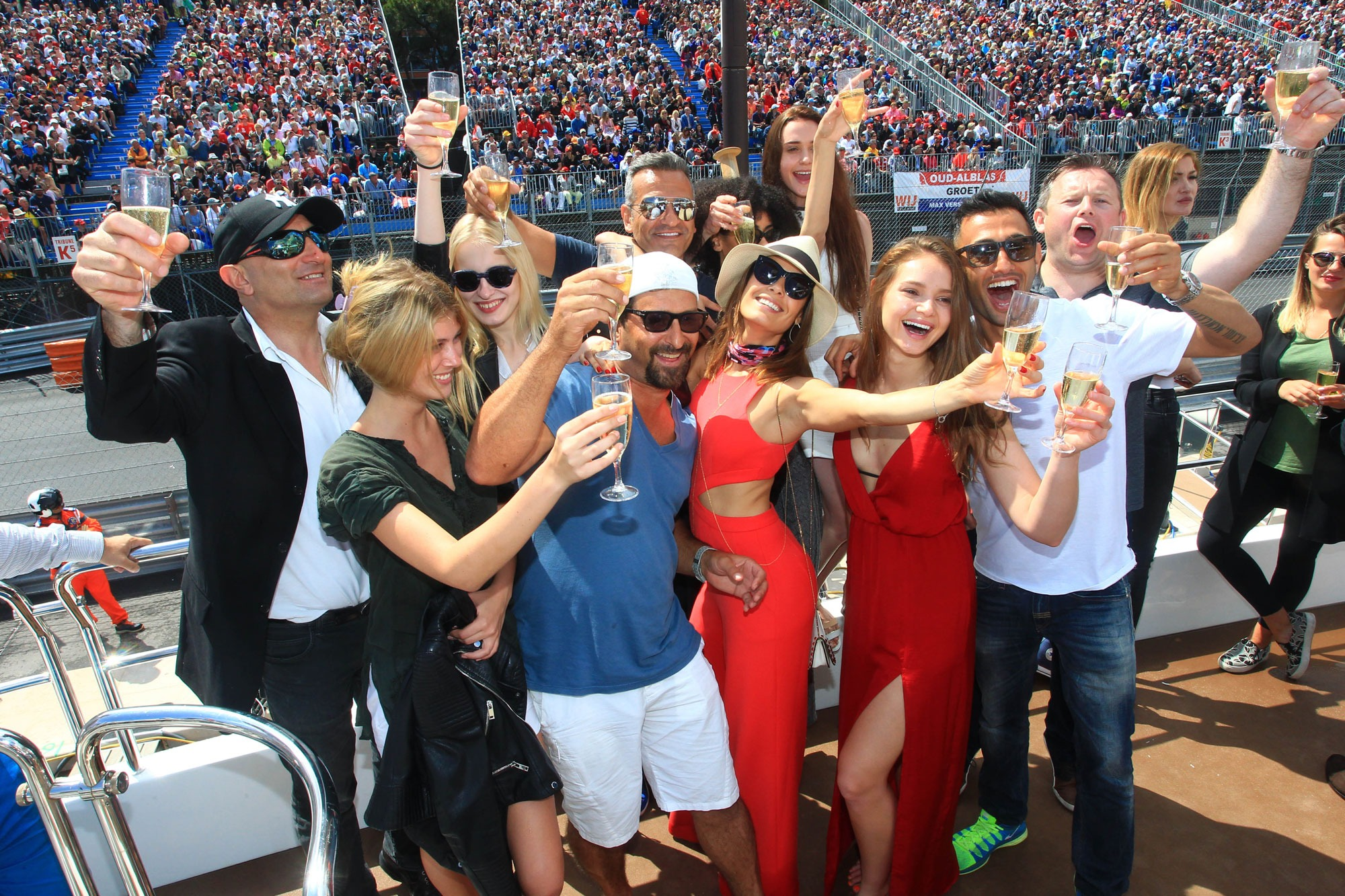 guests with champagne at monaco grand prix yacht party