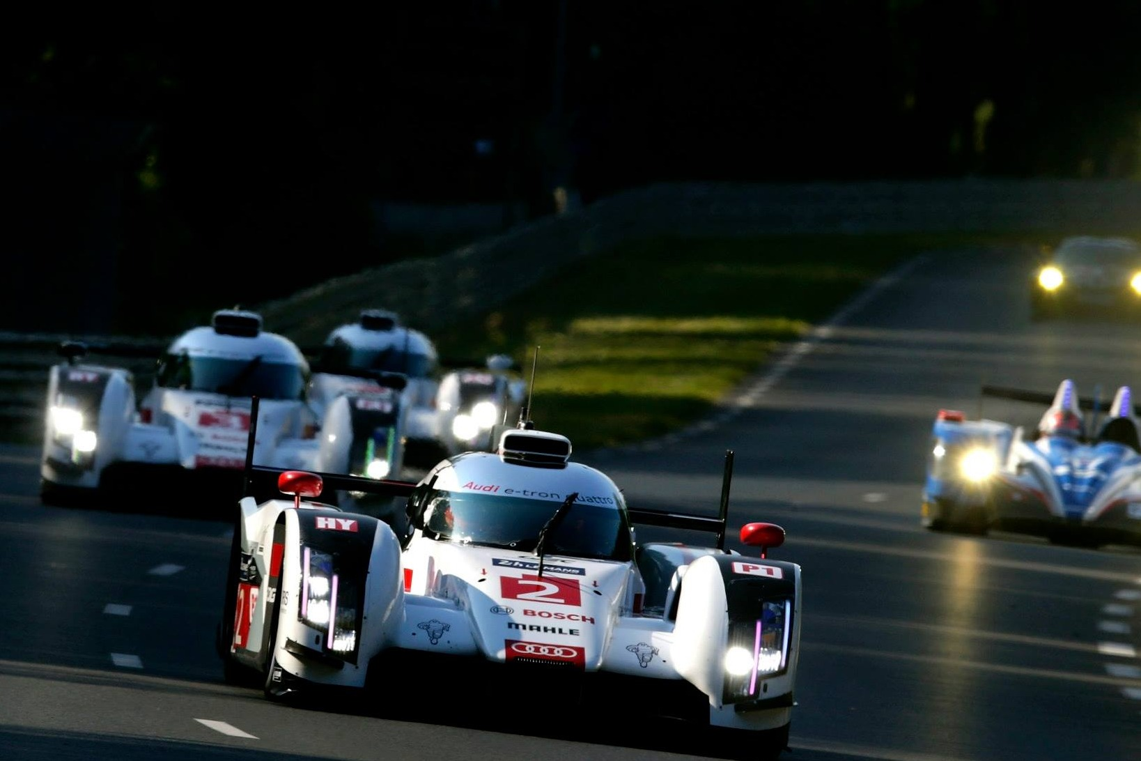 Racecars on the track at Le Mans 24 Hours