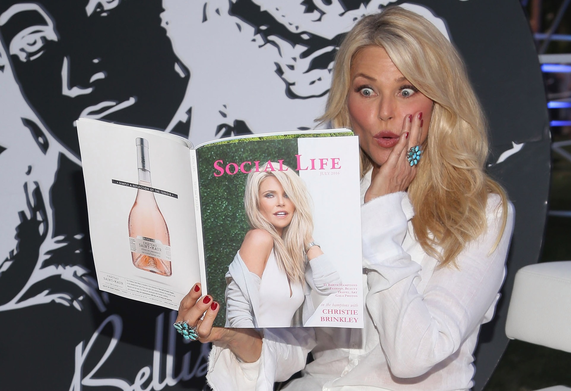 christine brinkley posing with magazine at St Barth Hamptons Annual Event