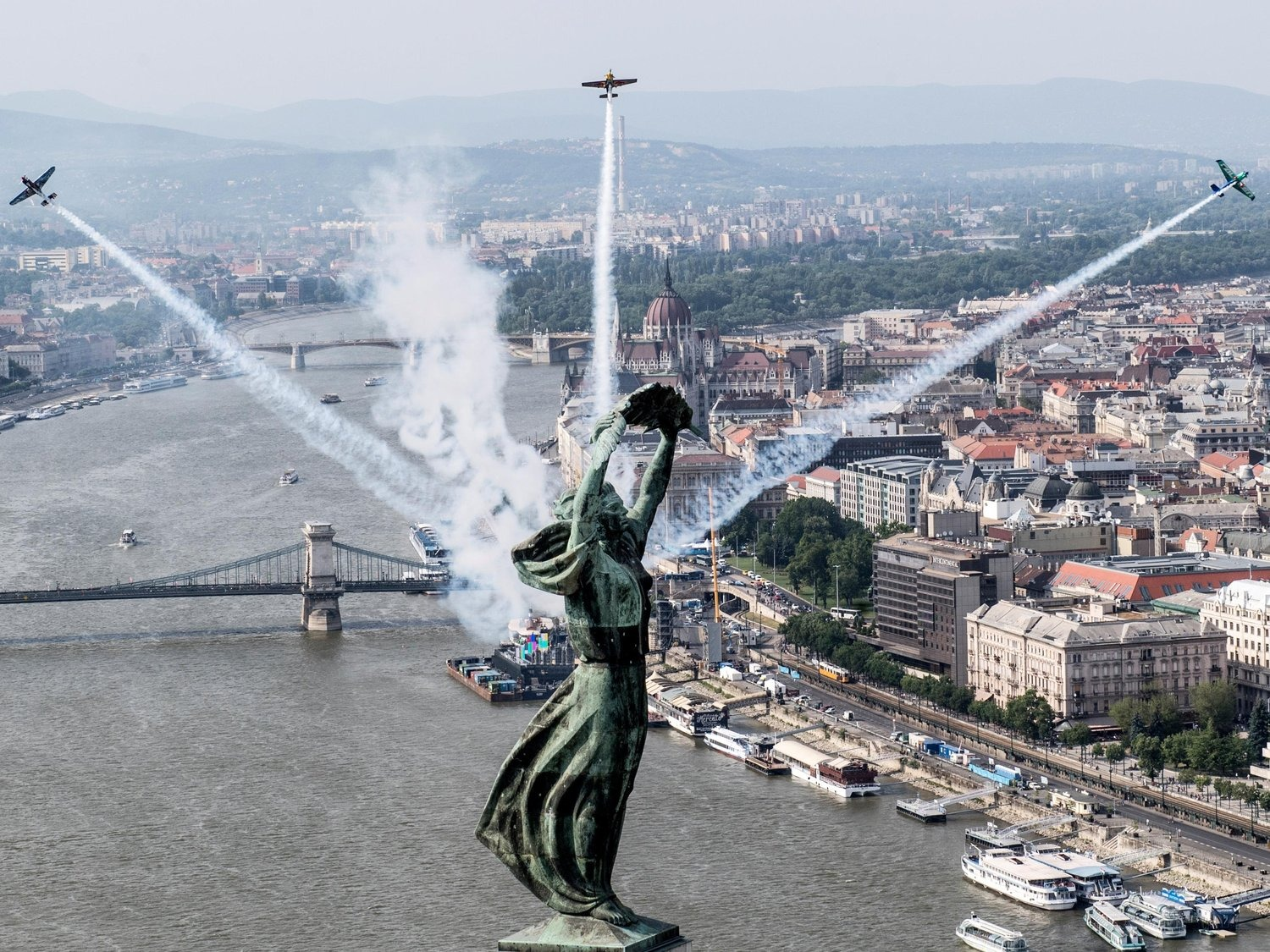statue and planes at Red Bull air race Budapest
