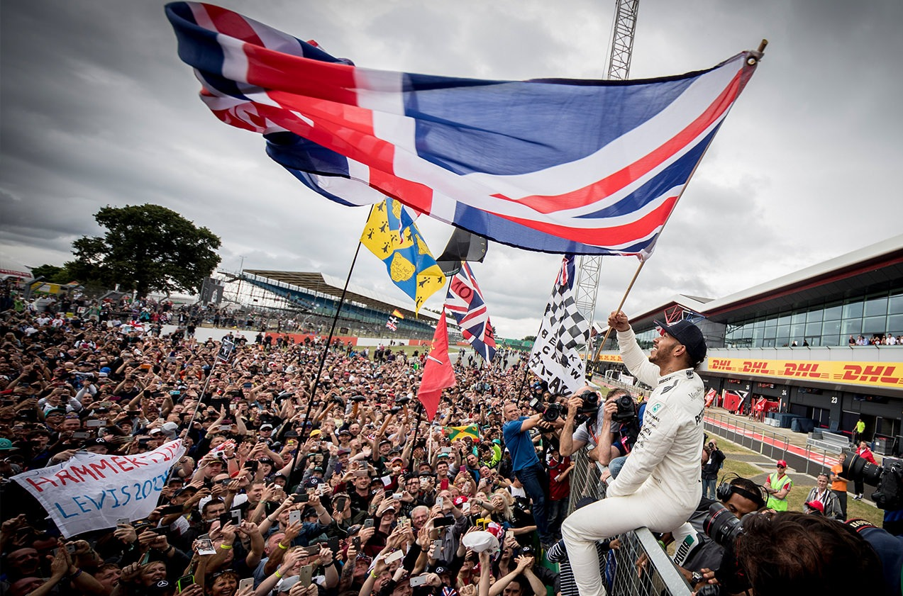 crowds with flag at british grand prix with lewis hamilton