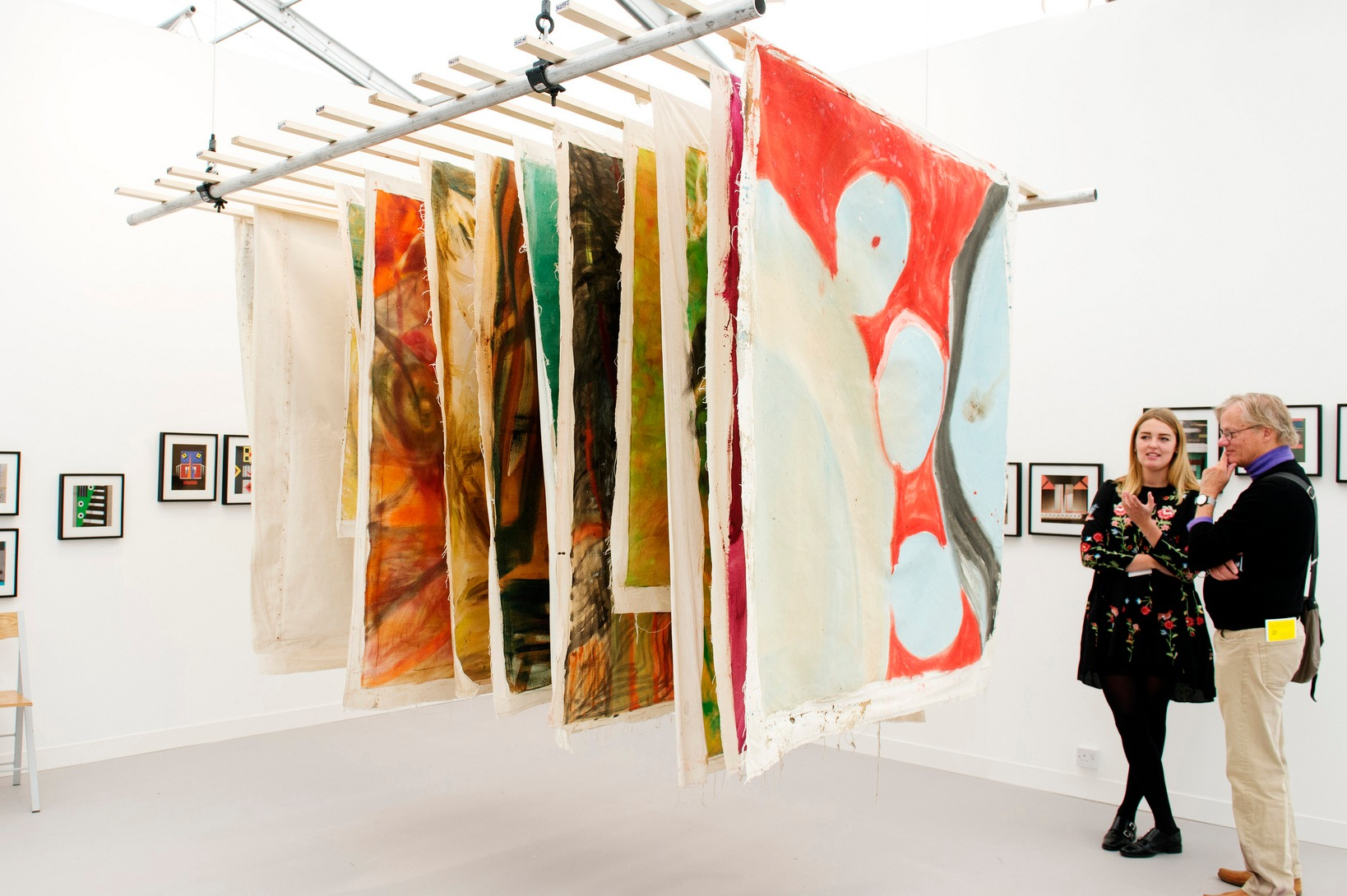 Visitors admiring art work at Frieze Art Fair
