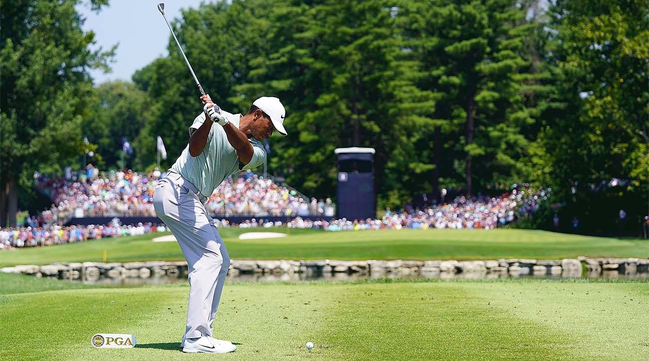 Golfer swinging club at PGA Championship 2019