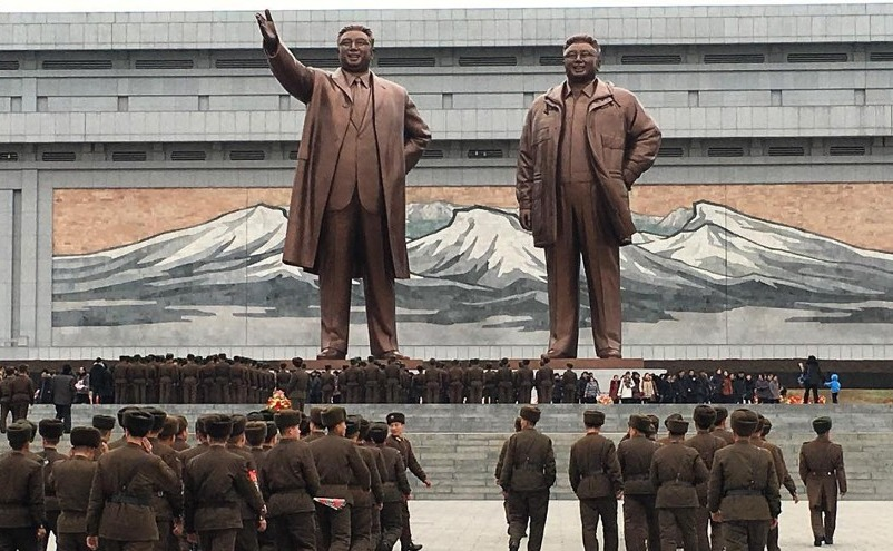soldiers inside North Korea paying respects to leader statues