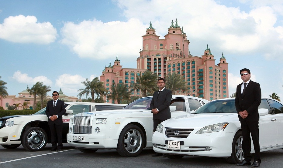 chauffeurs posing with bentleys in dubai
