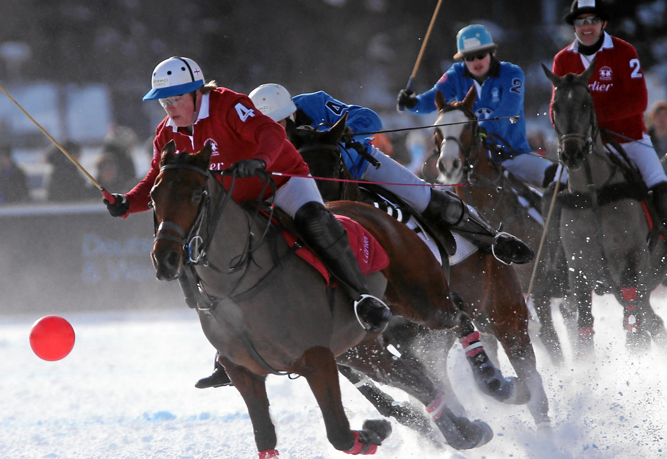 Players and horses competing at Cartier Snow Polo World Cup, St Moritz