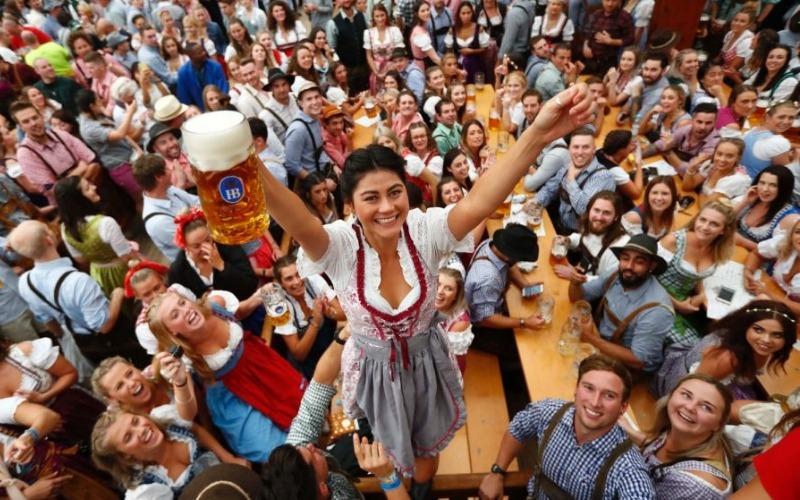 Oktoberfest guests enjoying beer in Munich