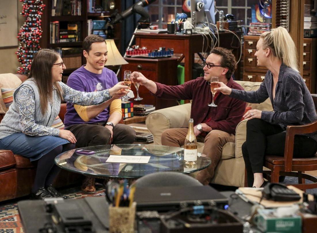 big bang theory cast clinking glasses