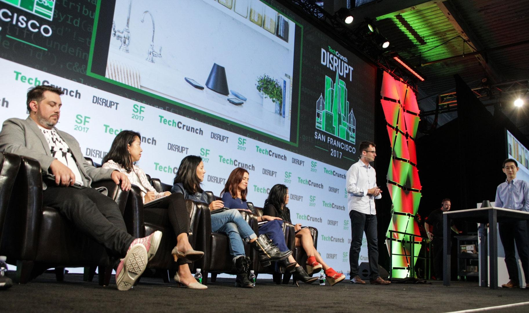 speakers on stage at tech crunch disrupt