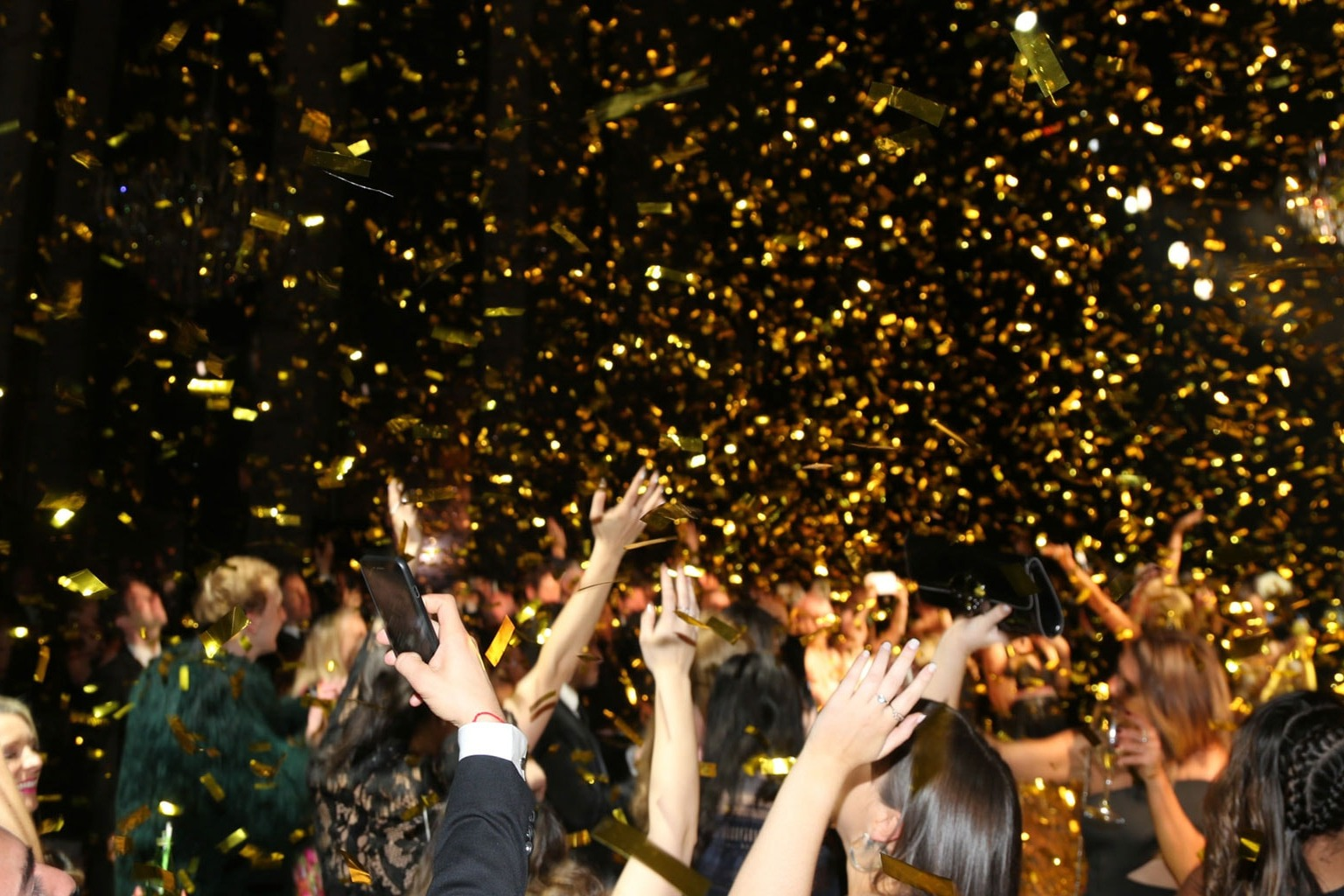 Guests celebrating with glitter in the air at NGV Gala Ball