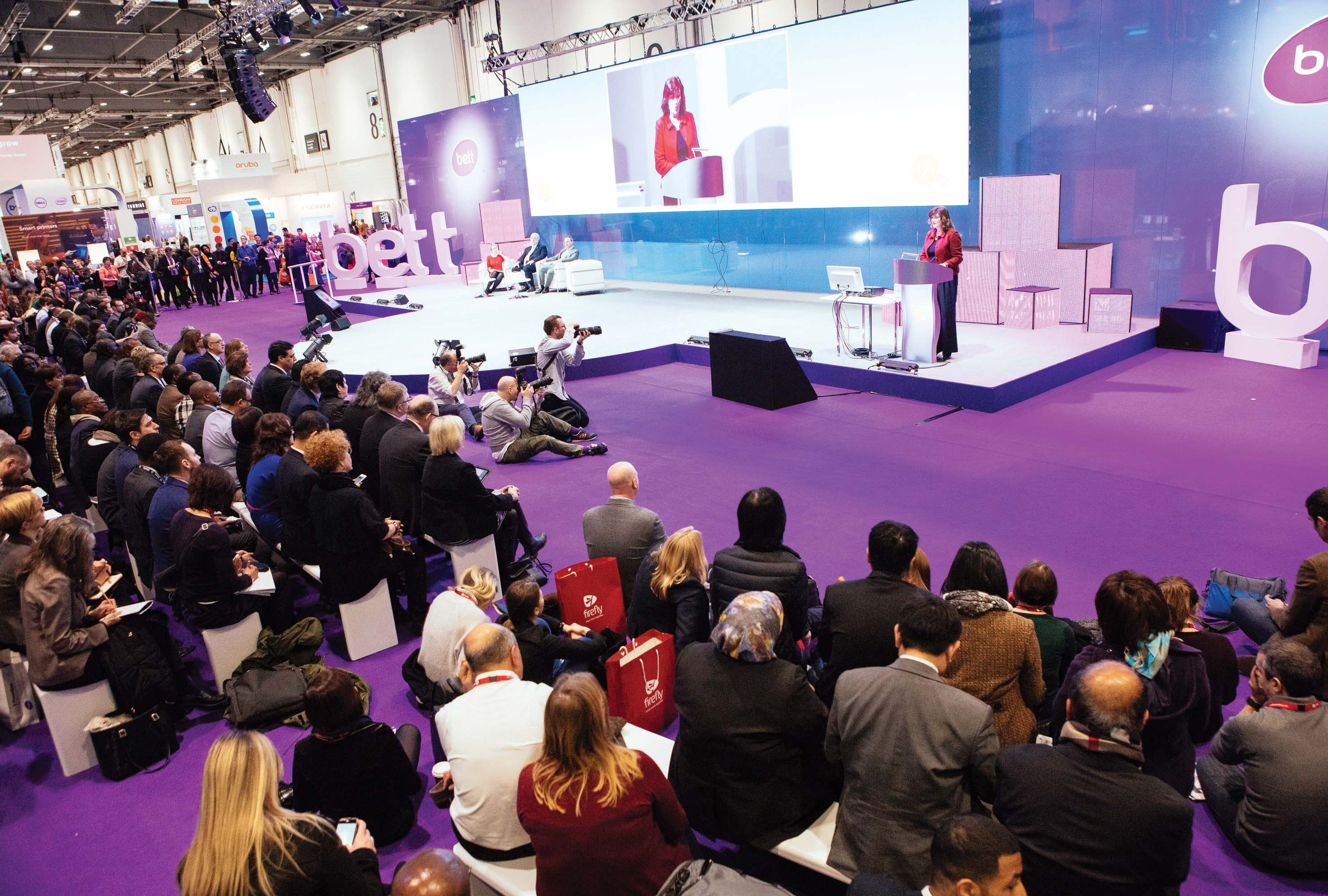 Attendees listening to speaker at Bett Conference