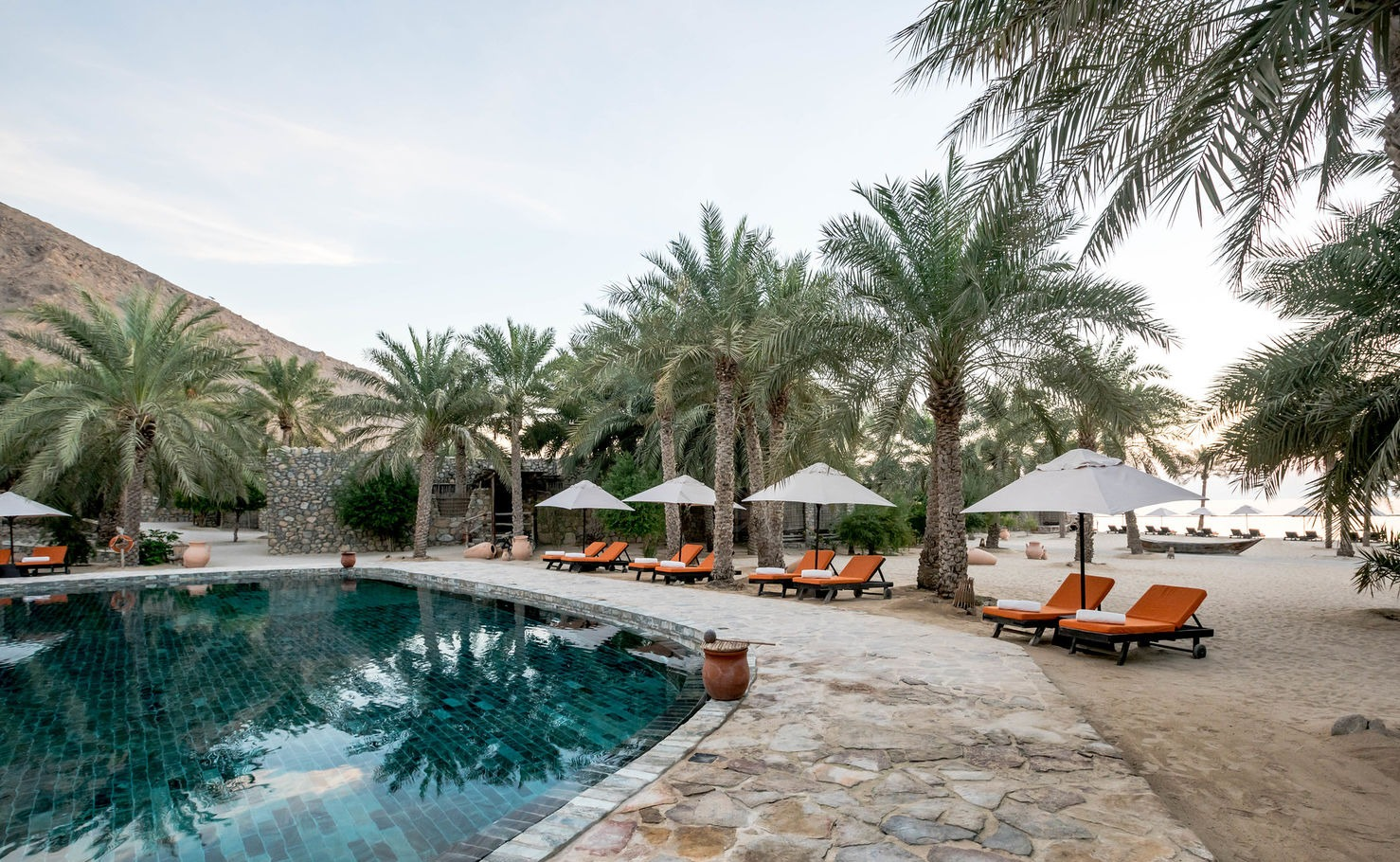 pool and palm trees at zinghy hotel you can paraglide to