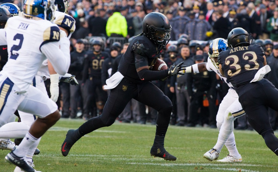 players at army navy football game