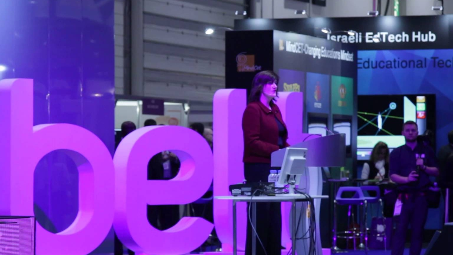 Speaker addressing audience in front of Bett letters at Bett Conference