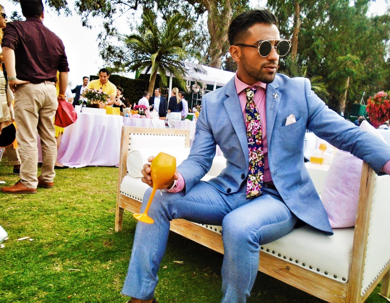 Man in suit drinking Veuve Clicquot at Polo