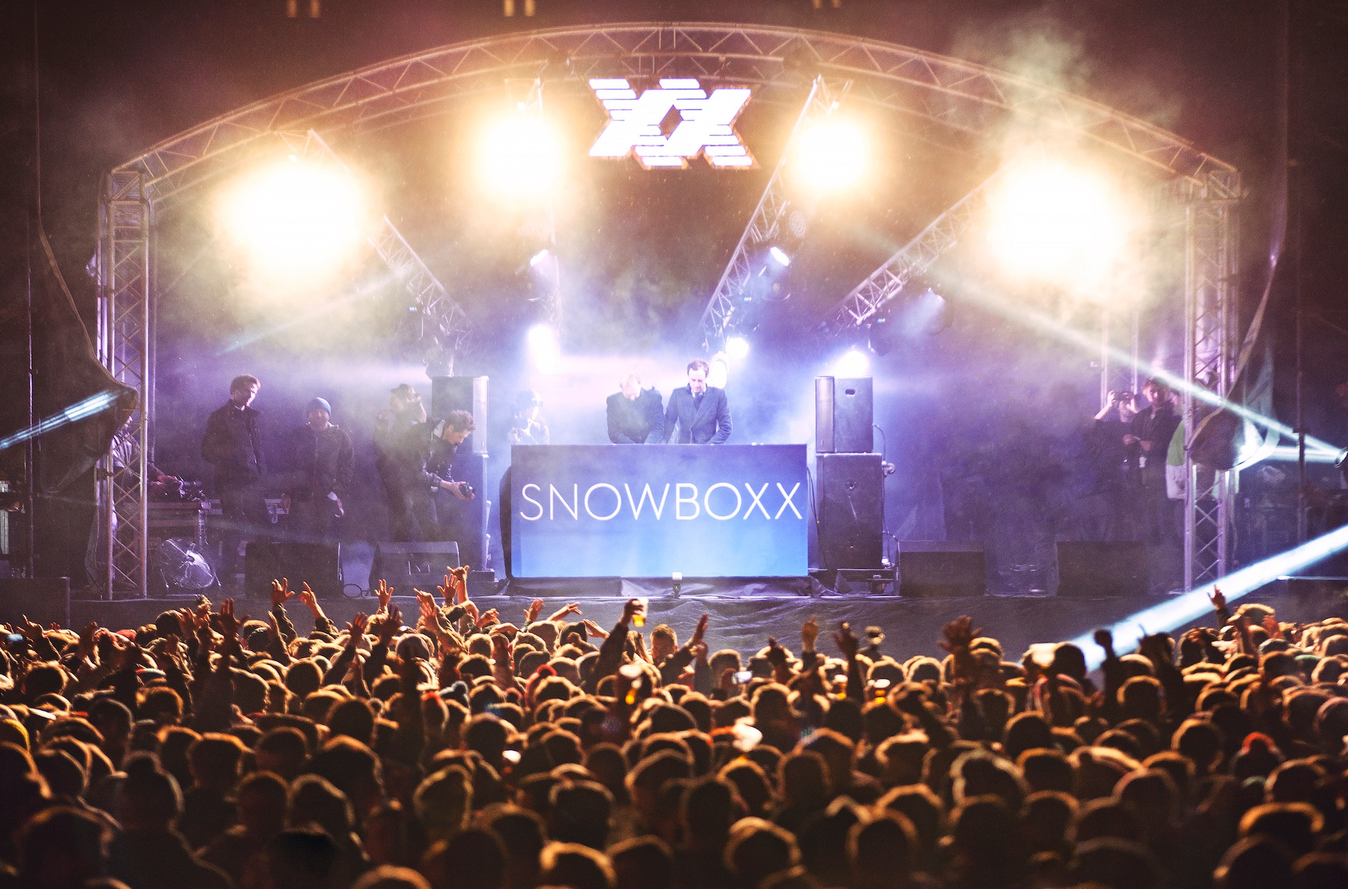 Crowd dancing in front of DJ on stage at Snowboxx festival, Alvoriaz