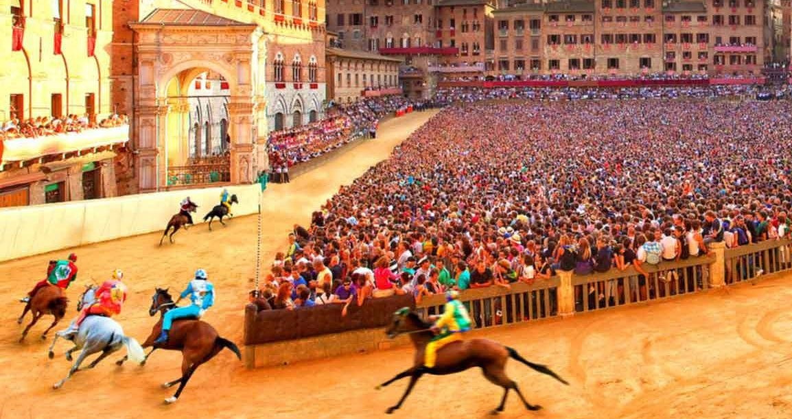 Palio di Siena riders racing horses around crowd of spectators