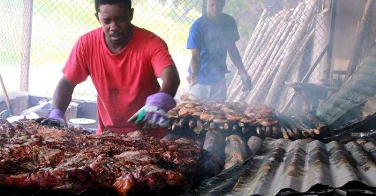 Men Cooking Real Jamaican Jerk Chicken