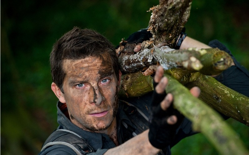Bear Grylls with mud on his face at Bear Grylls Survival Academy