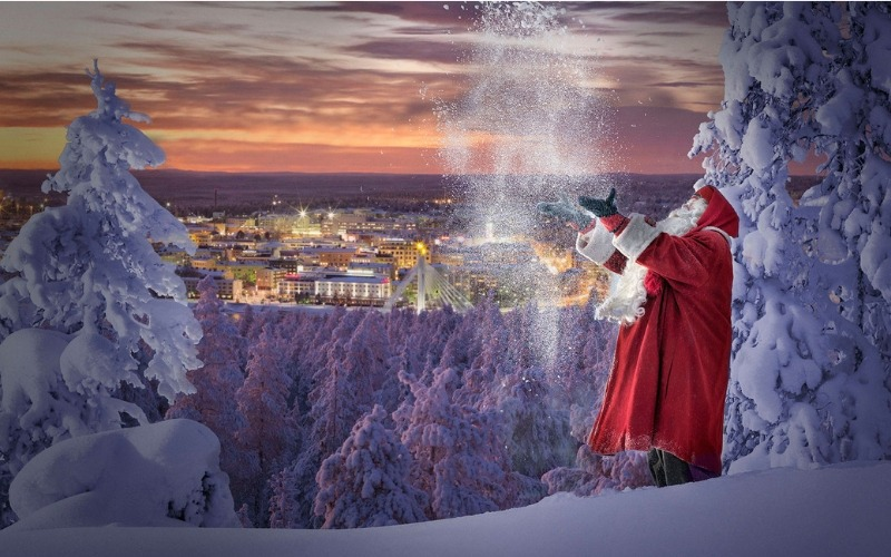 Father Christmas with snow as part of Spend Christmas at Santa's Lapland