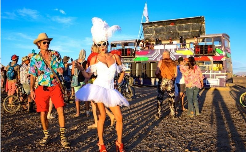 Afrikaburn partygoers in costume posing