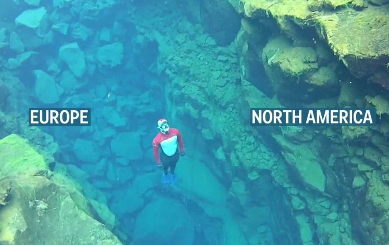 Free diver swimming between two continents
