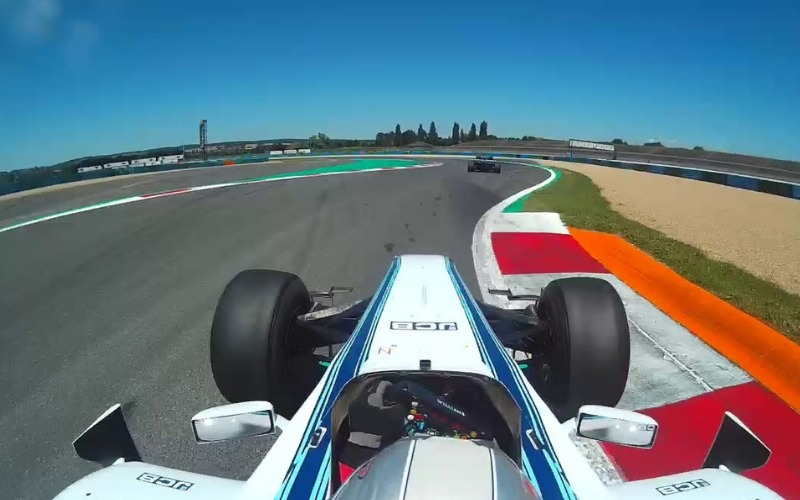 Formula 1 car driving on Magny race cours