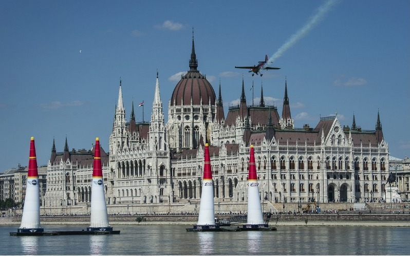 Red Bull Air Race Budapest - stunt plane in front of Hungarian Parliament