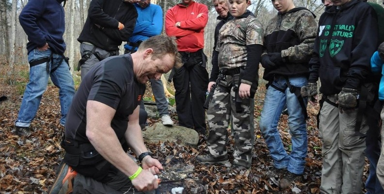 Making a fire at Bear Grylls Survival Academy