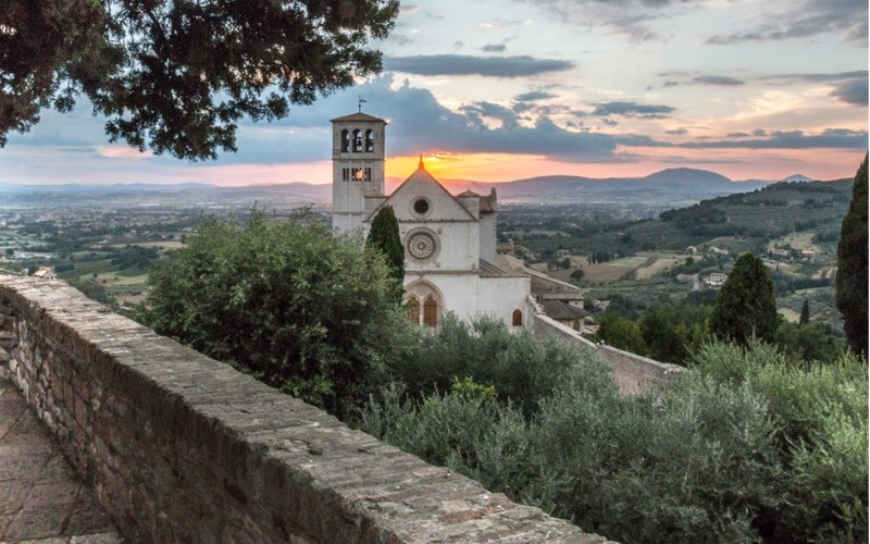 Sunset behind a church on 6 Day Meditation Retreat to Assisi