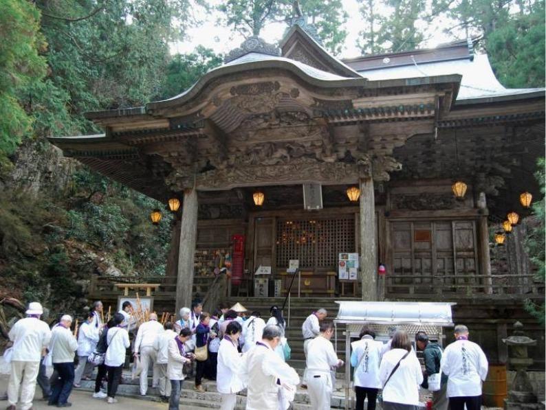 pilgrims at a temple in shikoku japan