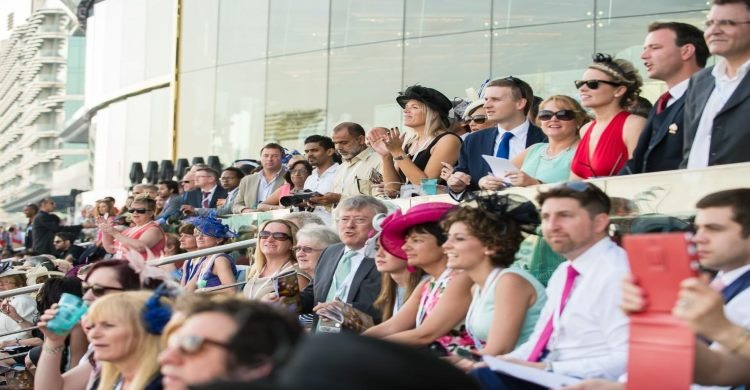 Race goers enjoying the Dubai World Cup Horse Racing
