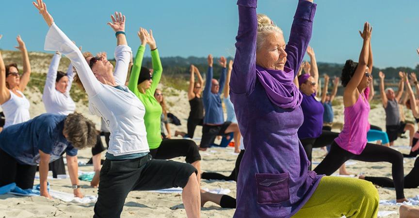 Yoga on the beach at Silent Awakenings retreat