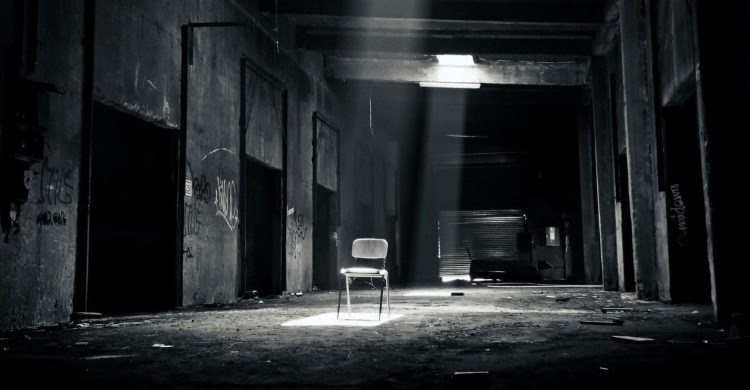 Kidnap, capture event. Dark room, light overhead and chair