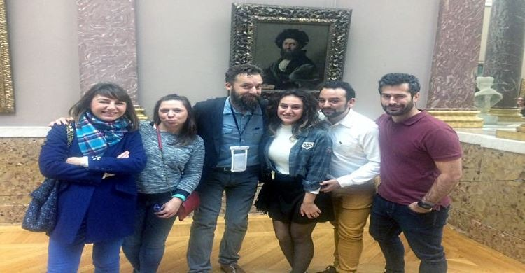 Cedrik the host of laugh your way through le louvre with satisfied customers