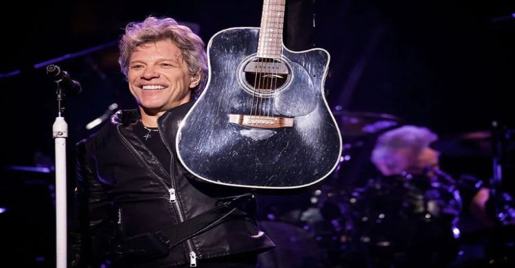 Jon Bon Jovi with guitar on stage