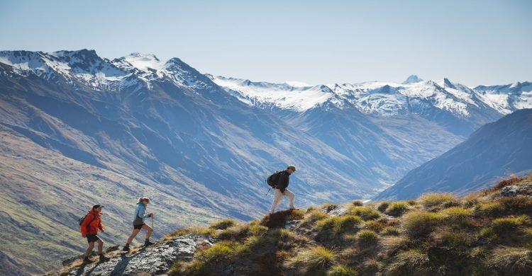 Trekkers in New Zealand approaching helicopter