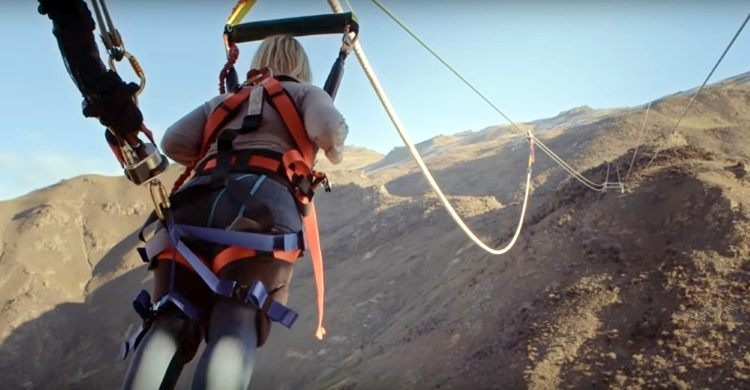 Human slingshot in New Zealand over looking canyon
