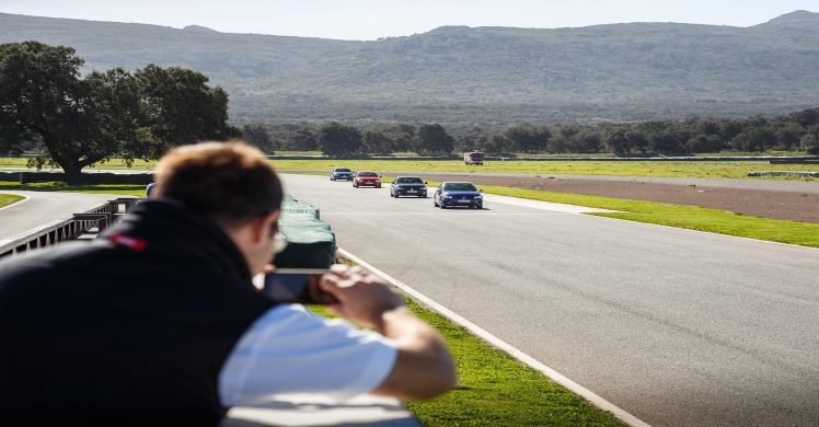 Photographer snapping cars lapping at Ascari