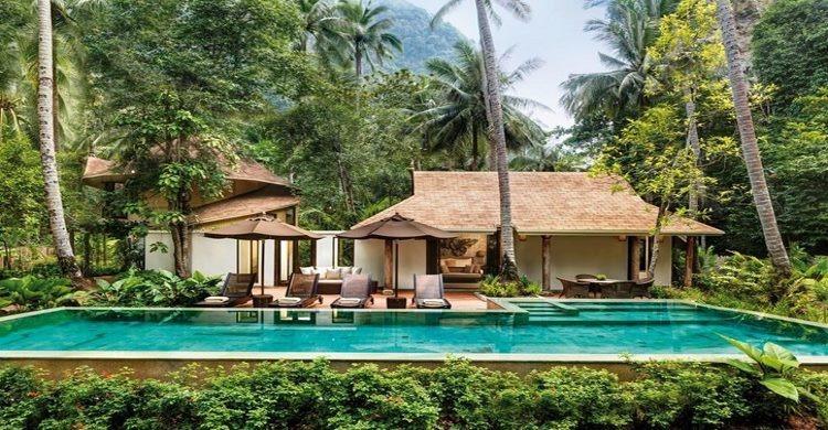 Luxurious beachfront accommodation along Krabi's Andaman Coast is provided at the 5-star Rayavadee hotel