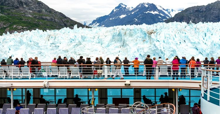 Cruisers onlook in amazement at glacier
