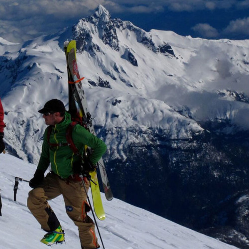 Man with skis with mountain views of the Andes - Life of Riley