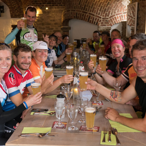 Cyclists drinking beer in Belgium Beer Bike Event