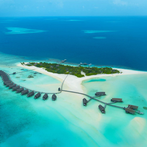 Aerial view of the turqouise sea and sands of Como Cocoa Island, Maldives