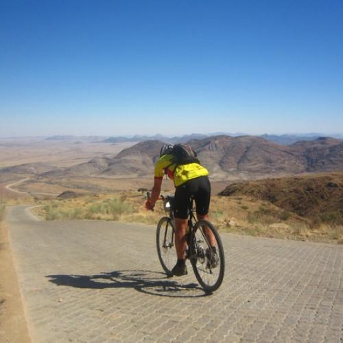 Cyclist on the road through Tour d'Afrique